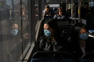 Lan Zhang and Elma Song, international students from China, travel on a bus as they go shopping, Sydney, Australia, 3 July 2020 (Photo: Reuters/Loren Elliott)