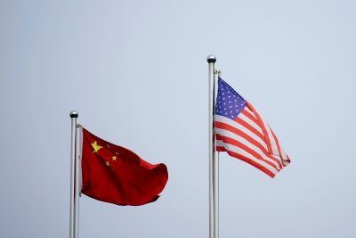 Chinese and U.S. flags flutter outside a company building in Shanghai, China 14 April 2021 (Photo: Reuters/Aly Song).