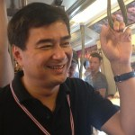 Abhisit Vejjajiva taking the BTS Skytrain during the Bangkok Shutdown protests