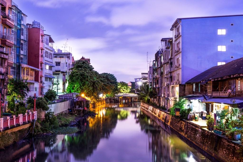 Condominium buildings on the river in Nonthaburi at night