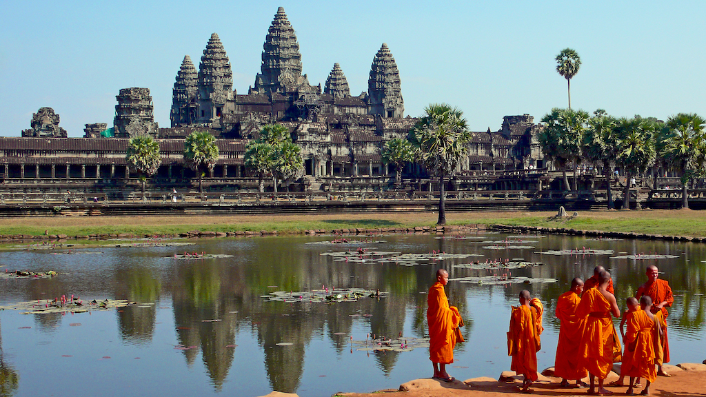Buddhist monks in front of Angkor Wat temple