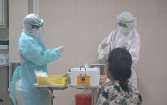 Healthcare workers performing COVID-19 coronavirus tests