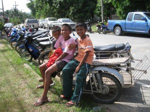 Thai children in a motorcycle sidecar