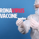 Doctor in face mask holding syringe with Coronavirus Vaccine text