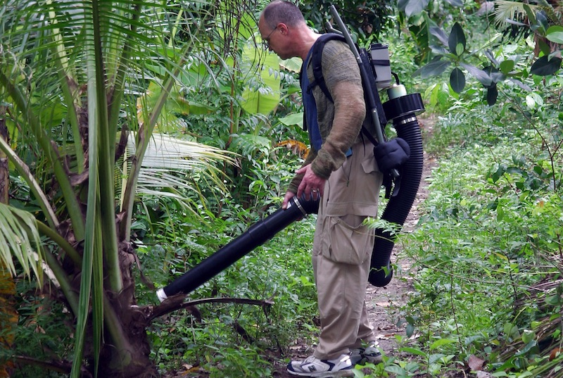 Entomologist using a large powered aspirator to collect mosquitoes in northern Thailand