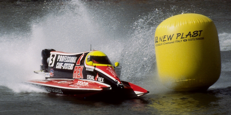 An F1 powerboat rounding a buoy