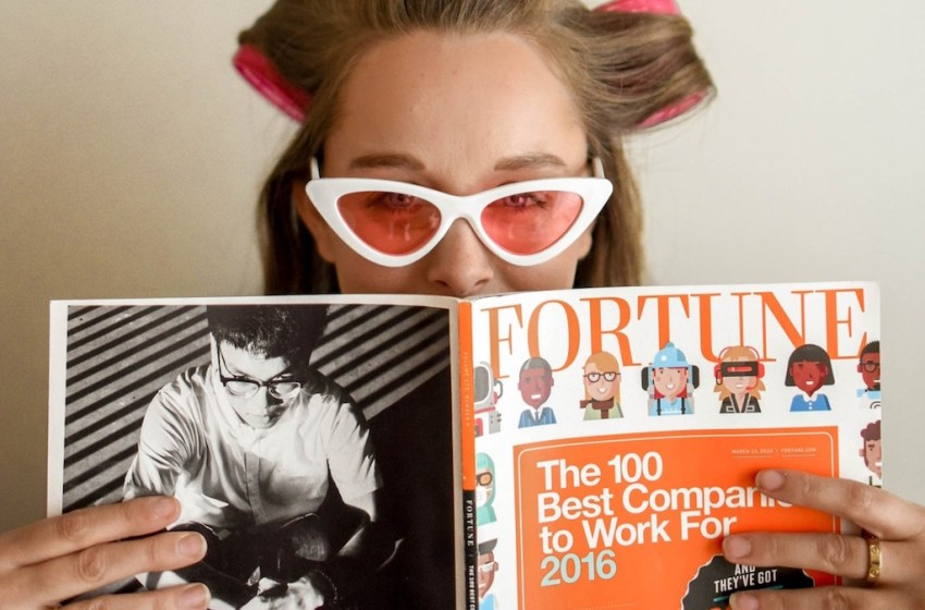 Woman reading the Fortune Magazine