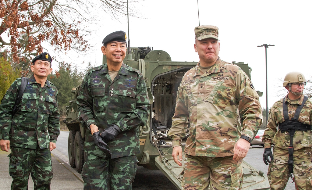 Maj. Gen. Mark Stammer (right), I Corps deputy commanding general, greets Royal Thai Army Lt. Gen. Apirat Kongsompong, First Army Area commander in Thailand