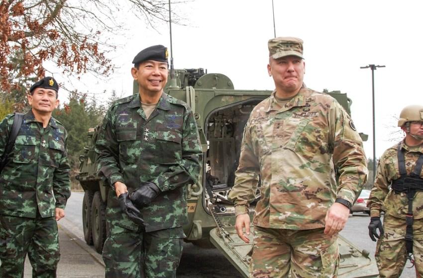 Maj. Gen. Mark Stammer (right), I Corps deputy commanding general, greets Royal Thai Army Lt. Gen. Apirat Kongsompong, First Army Area commander in Thailand