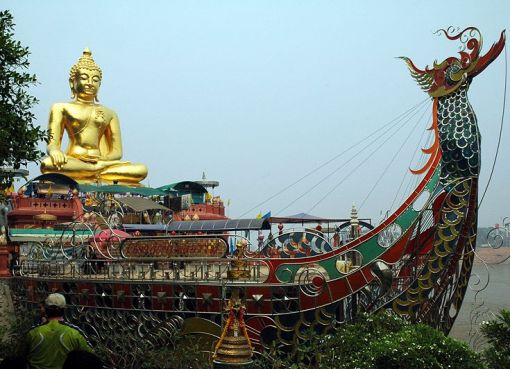 Giant Buddha behind a treasure ship in the Golden Triangle
