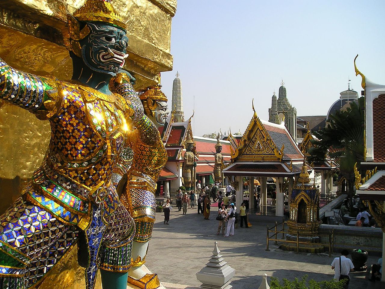 Crowds in yellow shirts show up to greet King and Queen at the Grand Palace