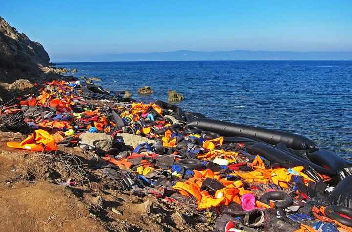 Life jackets belonging to refugees on a beach in Lesvos, Greece