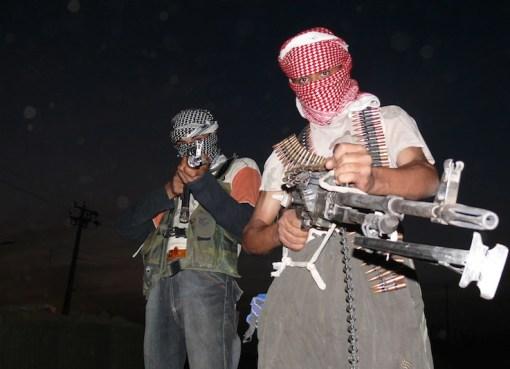Iraqi insurgents with guns