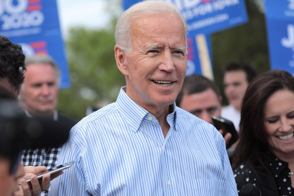Joe Biden walking with supporters at a pre-Wing Ding march from Molly McGowan Park in Clear Lake, Iowa