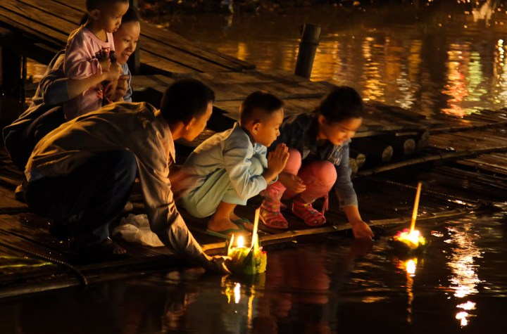 People floating krathongs during the Loy Krathong festival in Chiang Mai, Thailand