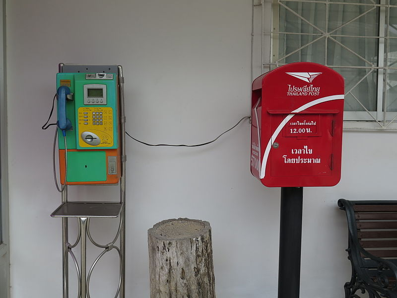 A phone and a post office mailbox