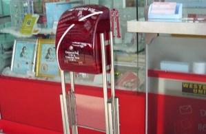 Transparent Thailand Post mailbox at Suvarnabhumi Airport, Bangkok