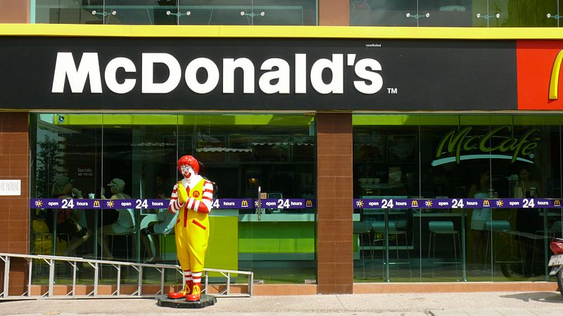 Ronald McDonald waai at McDonald's restaurant in Phuket