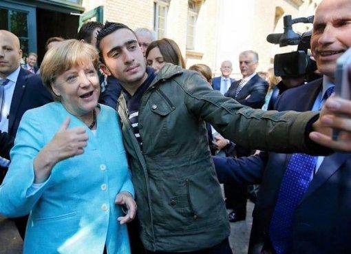 Angela Merkel selfie with Syrian refugee