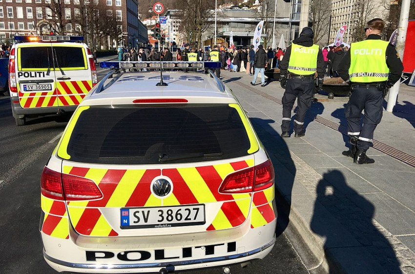 Norwegian police officers and Volkswagen and Mercedes-Benz police cars