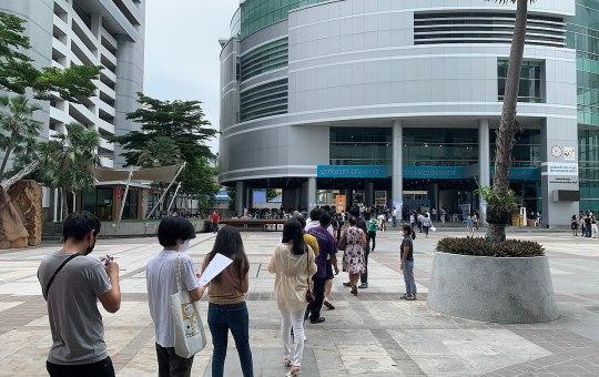 People queuing for COVID-19 vaccination at Srinakharinwirot University in Bangkok