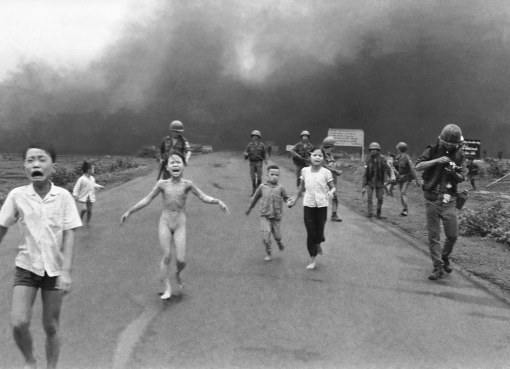 9-year-old Phan Thị Kim Phúc (center) and other children running down Route 1 near Trảng Bàng in Vietnam, after a South Vietnamese plane accidentally dropped napalm on South Vietnamese troops and civilians on June 8, 1972