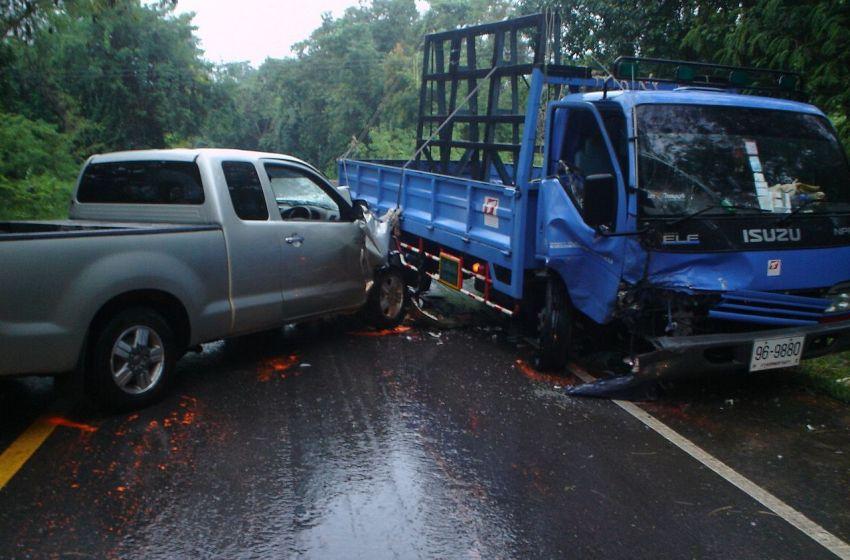 Pickup and blue truck crash