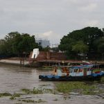 A boat and Pom Phet fortress in Ayutthaya