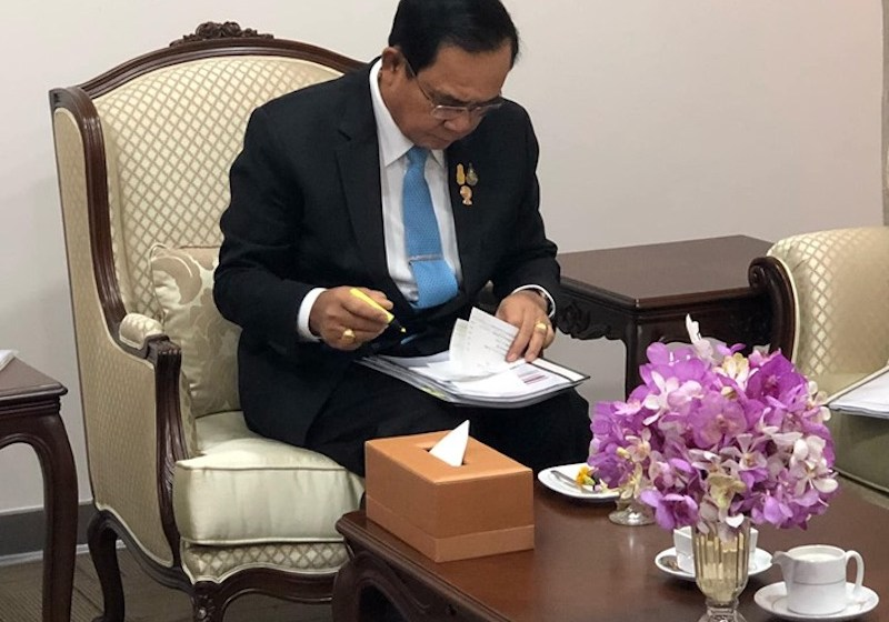 Prime Minister of Thailand Prayut Chan-o-cha examining documents