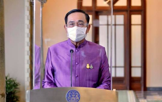 Prime Minister Prayuth Chan-ocha offering a televised address talking about the latest situation of COVID-19 pandemic in the country