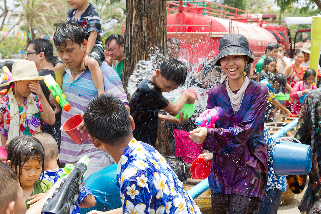 Beautiful girl splashing water at Songkran festival in Ayuttaya