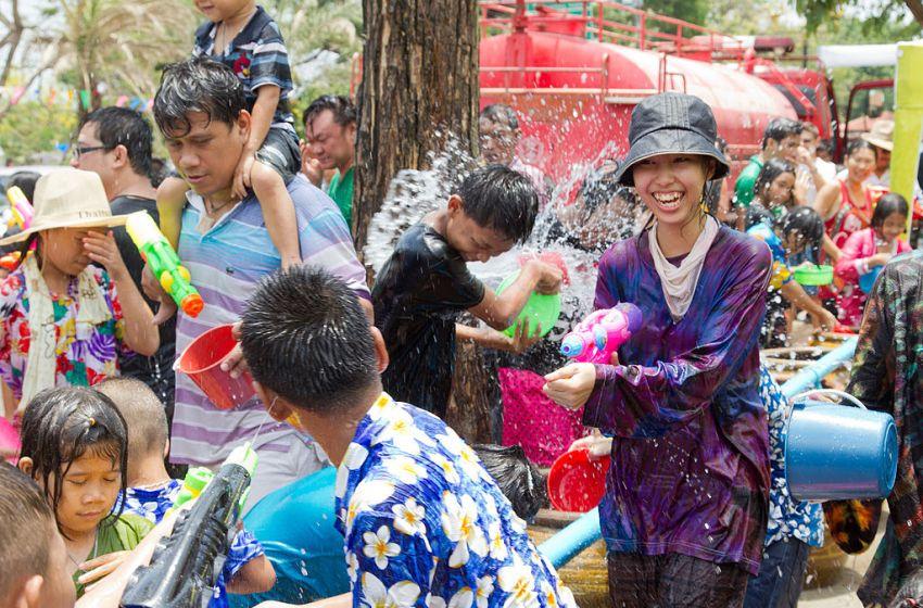 Beautiful girl splashing water at Songkran festival in Ayuttaya