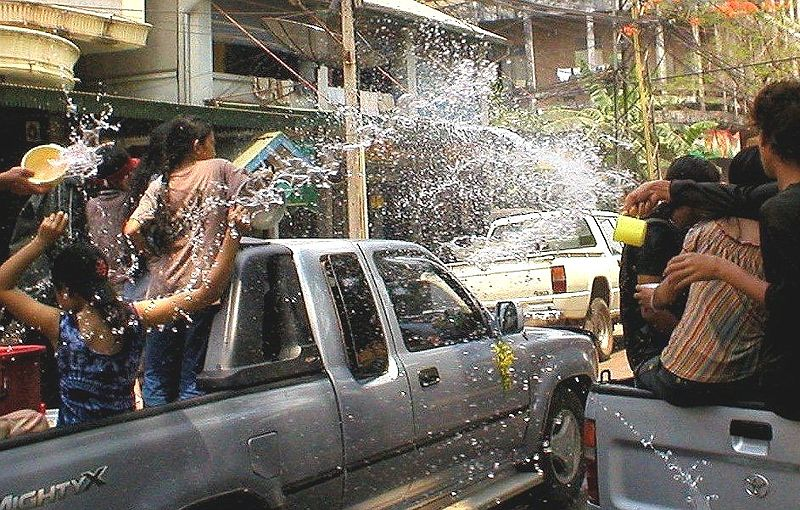 Water fight on top of pickup trucks during the Songkran Festival
