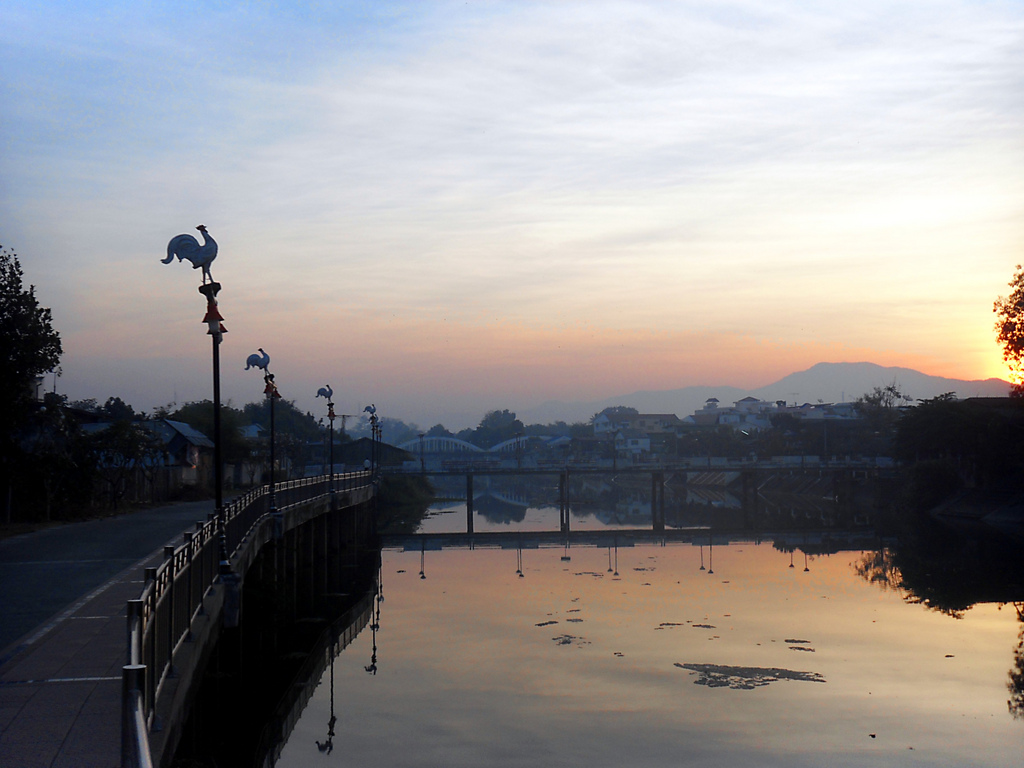 Sunset over a river in Lampang