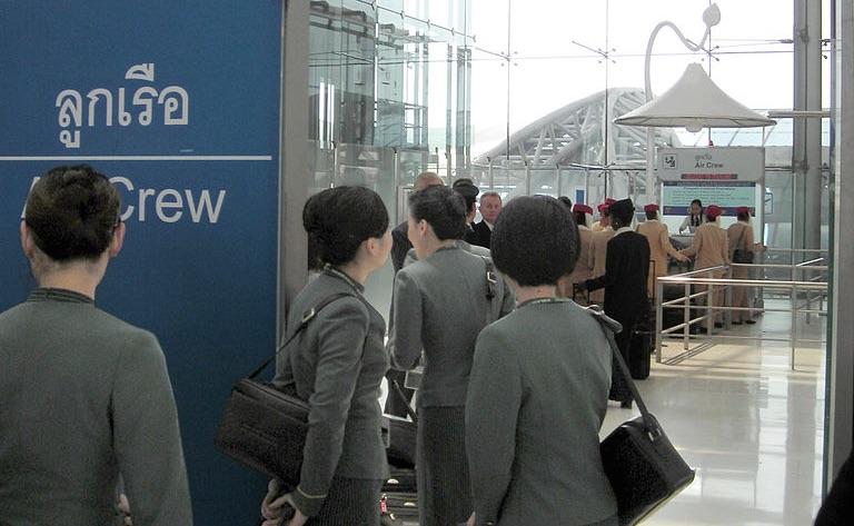EVA Air flight attendants at a crew counter of the Immigration Bureau at Suvarnabhumi Airport, Bangkok