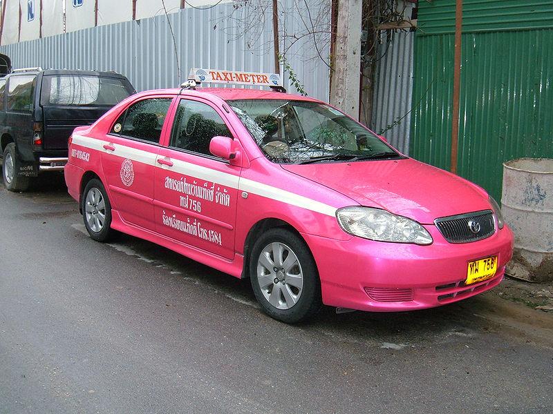 Pink Toyota Corolla E120 taxi in Bangkok