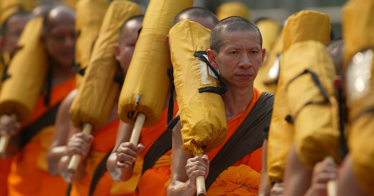 Buddhist monks dressed with orange robes