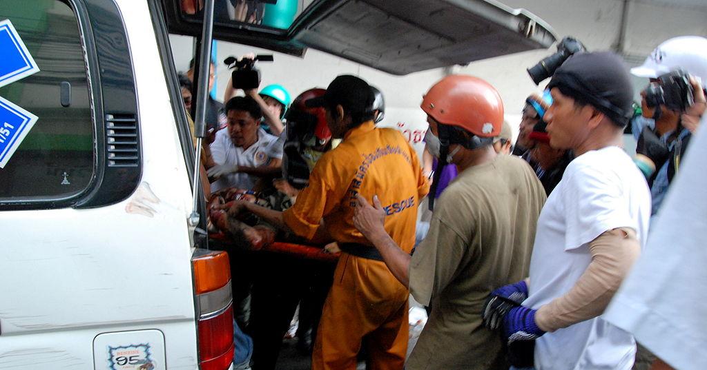 Injured man hauled in to the ambulance