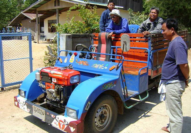 Thai farmers on a truck with a 9 HP, 1 cylinder diesel Kubota engine