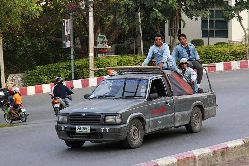 Workers in a pickup truck in Chonburi, Thailand