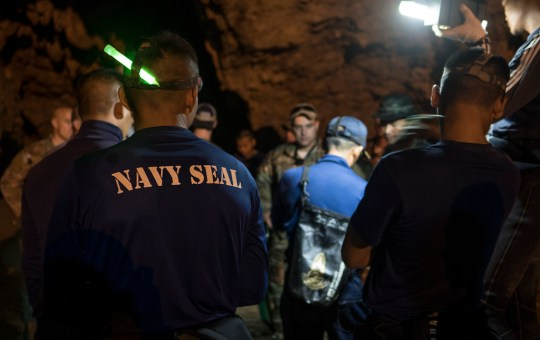 U.S. military and Thai Navy SEAL members during the rescue of the soccer team boys at Tham Luang cave