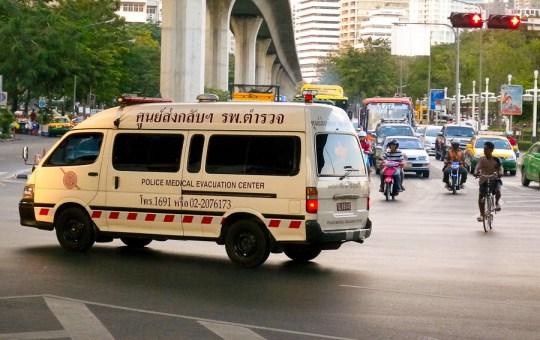 A Toyota Hiace ambulance of the Royal Thai Police Medical Evacuation Center on Rama IV Road, Bangkok