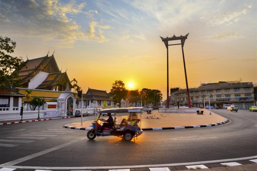 Tuk tuk in front a temple in BKK