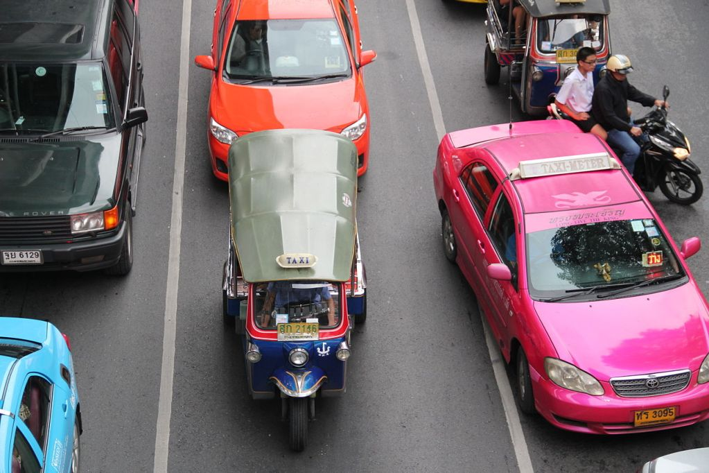 A tuk tuk and a taxi in Bangkok