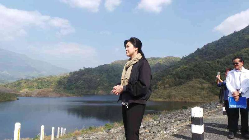 Yingluck Shinawatra visiting a reservoir
