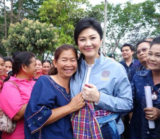 Yingluck Shinawatra surrounded by supporters