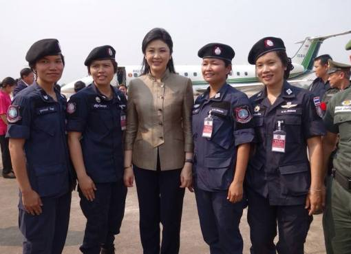 Ex-premier Yingluck Shinawatra poses for pictures with military women