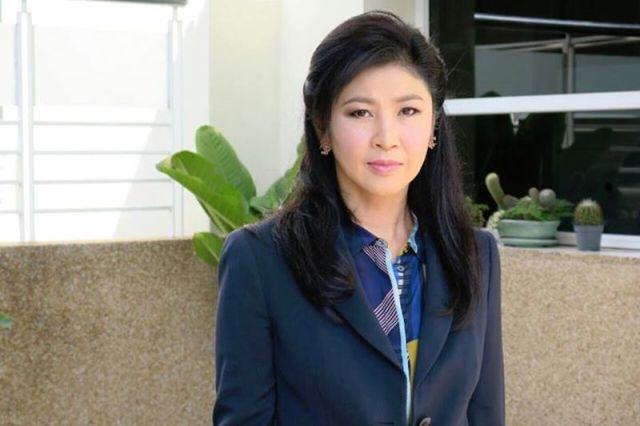 Yingluck stands trial for rice scheme amid supporters