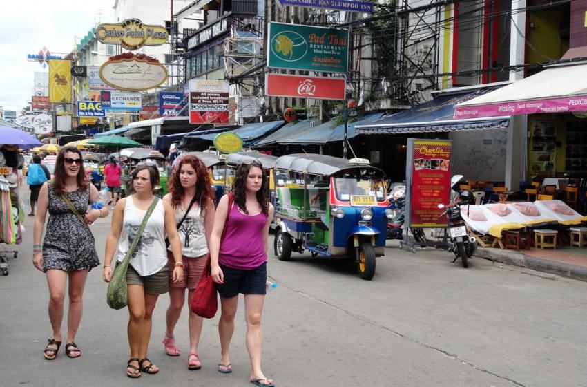 Four tourists on Khao San Road in Bangkok