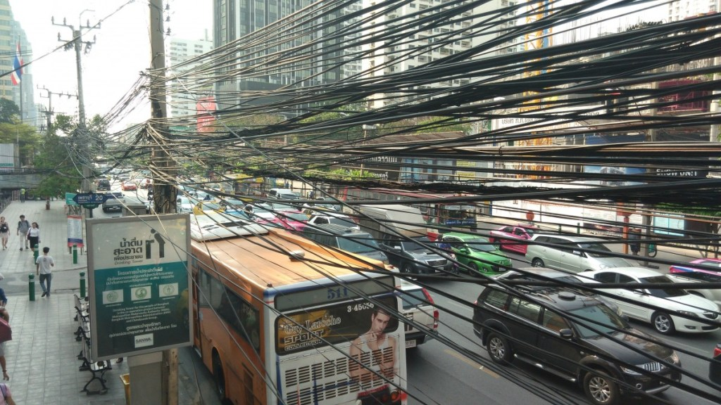 Bus and power cables on a busy street in Bangkok